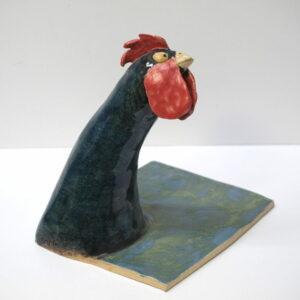 Vaciabolsillos y porta-mascarillas con la figura de un gallo