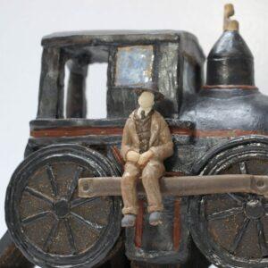 Escultura cerámica del maquinista de la General