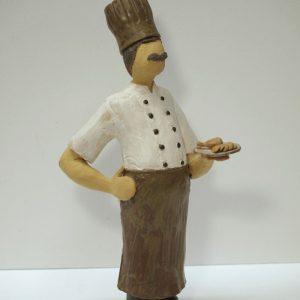 Escultura cerámica de un cocinero
